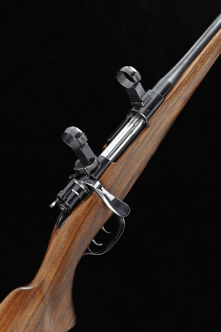 A .318 BOLT-ACTION SPORTING RIFLE 23 1/2-inch
