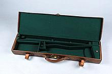 A LEATHER GUN CASE with compartment blocked for