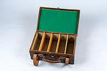 A BRASSBOUND LEATHER CARTRIDGE MAGAZINE for about