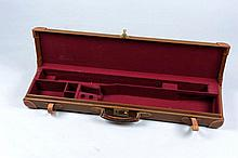 A LIGHTWEIGHT LEATHER GUN CASE with compartment