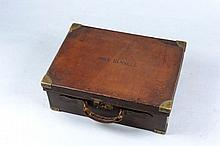 A LEATHER CARTRIDGE MAGAZINE for about 500 cases,