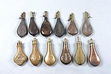 A GROUP OF SHOT AND POWDER FLASKS comprising: 6 leather bodied shot flasks