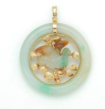 GOLD AND JADE PENDANT.