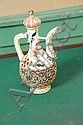 ZSOLNAY EWER. Stoppered ewer having floral transfer decoration, gilt accents and open work body. Impressed signature. 10
