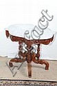MARBLE TOP PARLOR TABLE. White turtle shaped top on a elaborately carved and turned walnut base. 26 1/4