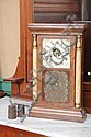 SETH THOMAS MANTLE CLOCK. Eight day time and strike with brass works and tin dial. Rosewood veneered case has reverse painted floral...