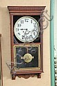 REGULATOR WALL CLOCK. Eight day time and strike with brass works by Sessions and tin dial. Oak case has a shell carved cornice, rope...