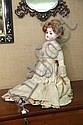 BISQUE HEAD DOLL. A Heinrich Handwerck doll with blue paperweight eyes and an open mouth. 23