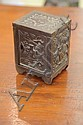 CAST IRON BANK. In the form of a safe with key lock door and floral and geometric decoration. Cast signature