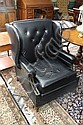 LEATHER ARMCHAIR. Black leather wing and button back. 37