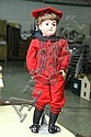 BISQUE HEAD BOY DOLL. Sleep eyes, open mouth with four teeth, jointed composition body and red clothes. Signed