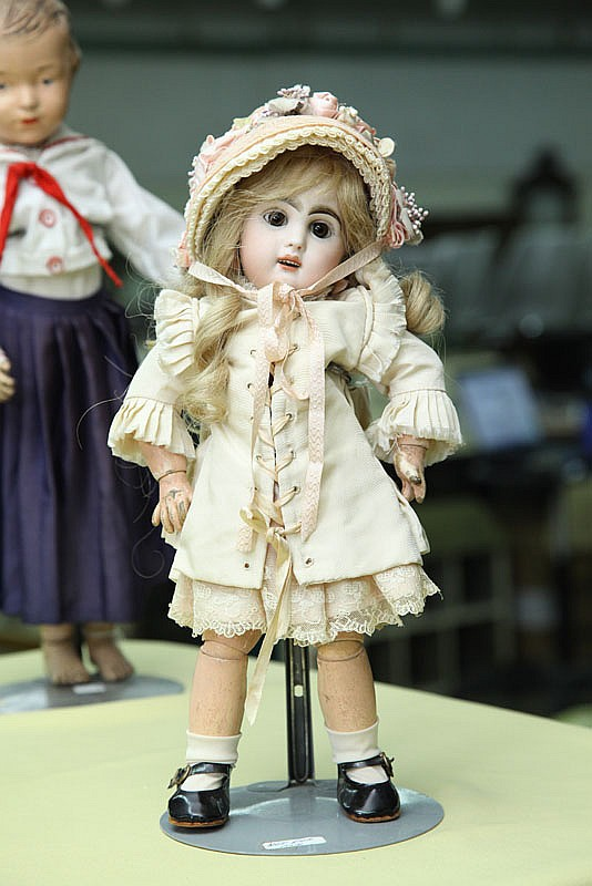 BISQUE HEAD DOLL. Tete Jumeau # 6. Stationary glass eyes, pierced ears and open mouth with six teeth on a jointed compostion body. S...