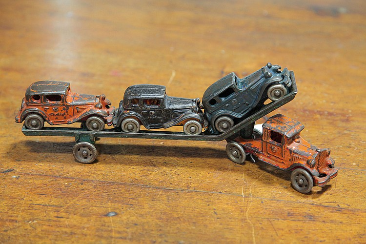 ARCADE CAST IRON SEMI-TRUCK AND TRAILER WITH CARS.