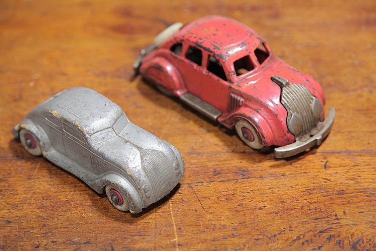 TWO CHRYSLER AIRFLOW TOYS.