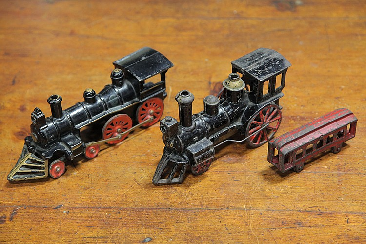 THREE CAST IRON LOCOMOTIVE TOYS.
