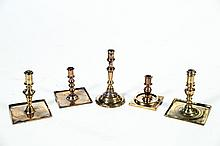 FIVE BRASS CANDLESTICKS.