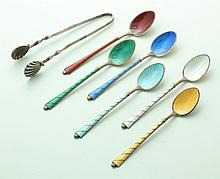 SET OF ENAMELED SILVER SPOONS AND A PAIR OF SILVER SUGAR TONGS.