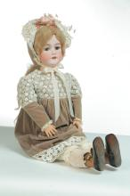 LARGE BISQUE HEAD DOLL.