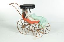 BISQUE HEAD DOLL IN CARRIAGE.