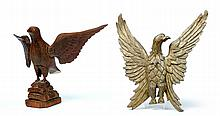 TWO CARVED WOODEN EAGLES.
