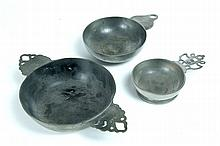 THREE PEWTER PORRINGERS.