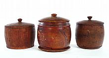 THREE TREENWARE COVERED JARS.