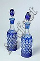 PAIR OF CUT OVERLAY GLASS DECANTERS.