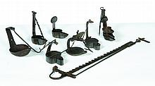 SEVEN PIECES OF FORGED AND CAST IRON LIGHTING.