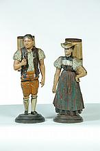 PAIR OF FIGURAL MATCH HOLDERS.