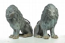 PAIR OF BRONZE SEATED LIONS.