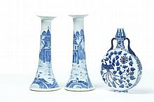TWO CHINESE CANDLESTICKS AND A VASE.