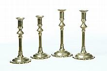 TWO PAIR OF ENGLISH BRASS CANDLESTICKS.