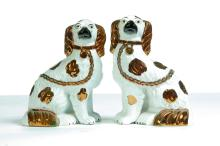 MIRRORED PAIR OF STAFFORDSHIRE SPANIELS.