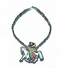 AMERICAN INDIAN INLAID SILVER NOVELTY FIGURAL PENDANT (LATE 20TH CENTURY).
