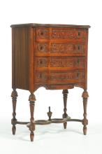 EUROPEAN-STYLE FOUR-DRAWER CABINET ON LEGS.
