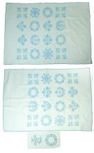 PAIR OF HAND STITCHED TWIN-SIZE QUILTS.