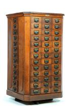 REVOLVING COUNTRY STORE SEED CABINET.