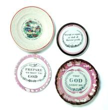 FOUR PIECES: THREE ROUND SUNDERLAND LUSTER FLUE COVERS WITH BIBLICAL SAYINGS AND A MAXIM PLATE.