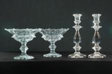 FOUR PIECES OF CLEAR CUT GLASS.