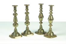 TWO PAIRS OF BRASS PUSH-UP CANDLESTICKS.