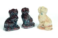 THREE AMERICAN POTTERY DOGS.