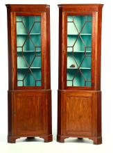 PAIR OF CHIPPENDALE-STYLE CORNER CUPBOARDS.