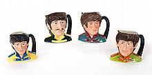 FOUR ROYAL DOULTON CHARACTER JUGS OF THE BEATLES.