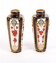 PAIR OF NICELY DECORATED ROYAL DOULTON VASES.