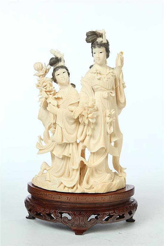 CARVED IVORY FIGURAL GROUP.