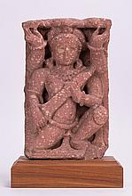 AN INDIAN CARVED SANDSTONE FIGURE