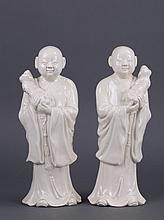 A PAIR OF CHINESE BLANC DE CHINE PORCELAIN LOHANS