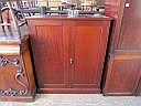 An Edwardian mahogany two door cupboard with