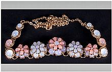 Peach, Lilac and White 'Cat's Eye' Floral Necklace, the centre front comprising double layered flowers set with the faux cat's eye stones, below single, larger similar stones, all in the pastel shades, with gilt mounts and chain; 18 inches long with
