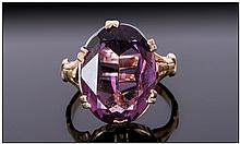 Amethyst Solitaire Ring, an oval cut held in a double prong setting in 9ct gold